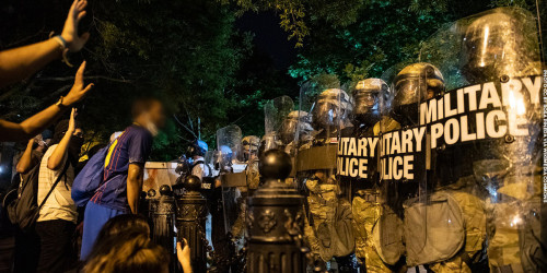Protesters and police. Photo by Rose Pineda